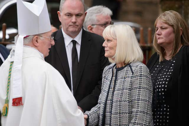 Archbishop Mario Conti speaks with Lord Martin's widow Mary (John Linton/PA)