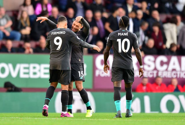 Roberto Firmino, left, and Sadio Mane celebrate in the win over Burnley