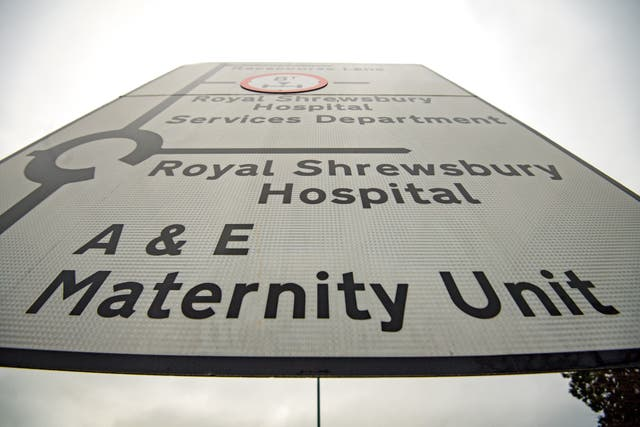 Road sign directing drivers to a maternity unit