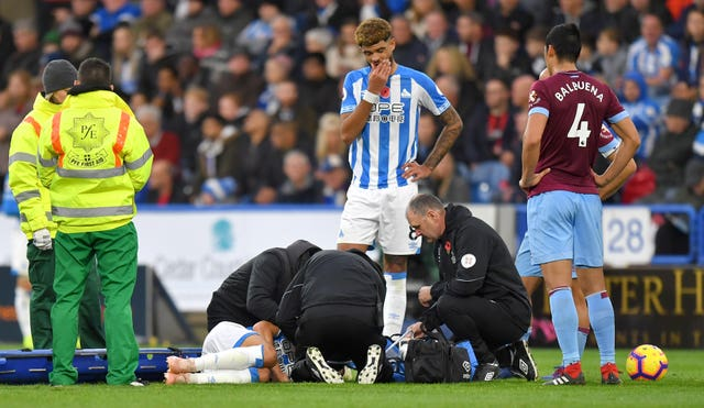 Huddersfield left-back Chris Lowe suffered a shoulder injury