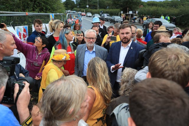 Jeremy Corbyn speaks to anti-fracking protesters outside the gate at the Preston New Road shale gas exploration site in Lancashire