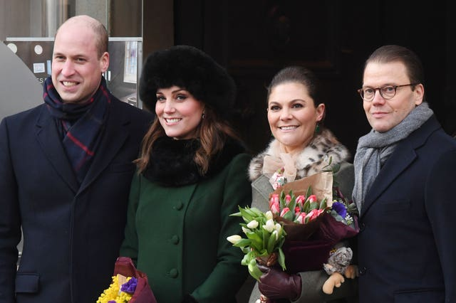 The Duke and Duchess of Cambridge, accompanied by Crown Princess Victoria and Prince Daniel of Sweden, walk from the Royal Palace of Stockholm to the Nobel Museum on the first day of their visit to Sweden. (Victoria Jones/PA)