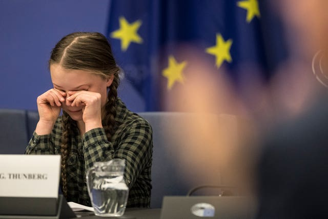 Young Swedish environmental activist Greta Thunberg reacts after giving a speech during a special meeting of the Environment Committee at the European Parliament