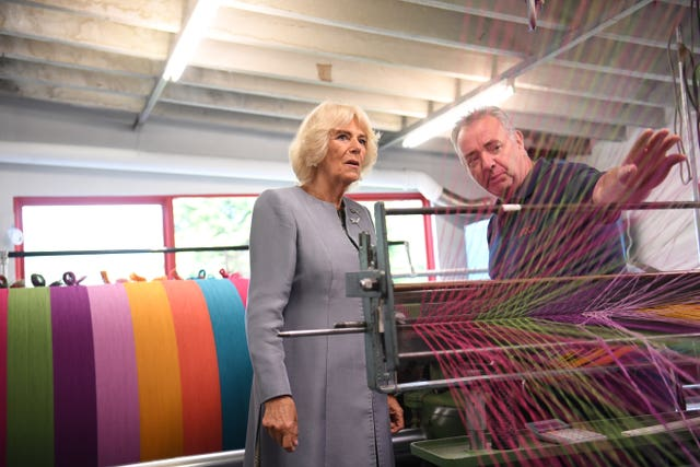 Camilla is shown a loom at Avoca Mill
