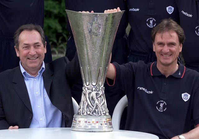 Houllier, left, guided Liverpool to a League Cup, FA Cup and UEFA Cup treble in 2001