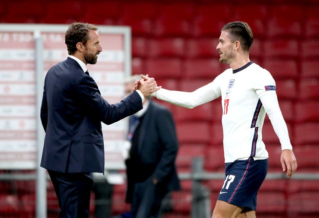 Gareth Southgate (left) shakes hands with Jack Grealish at the end of the match