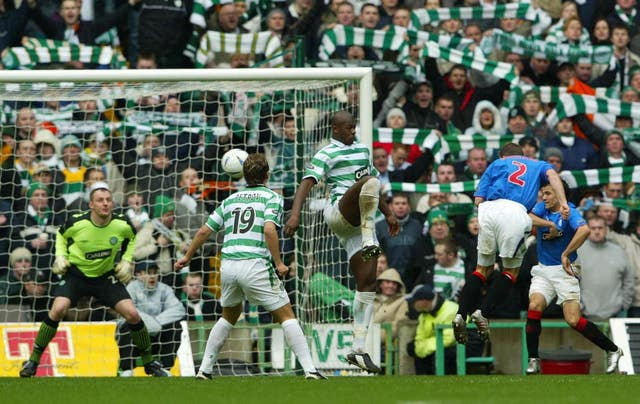 Fernando Ricksen heads home in an Old Firm derby