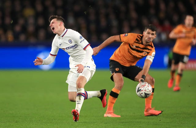 Chelsea's Mason Mount reacts to a challenge from Hull's Eric Lichaj