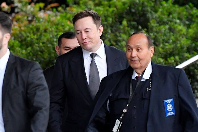 Tesla CEO Elon Musk, second from righ