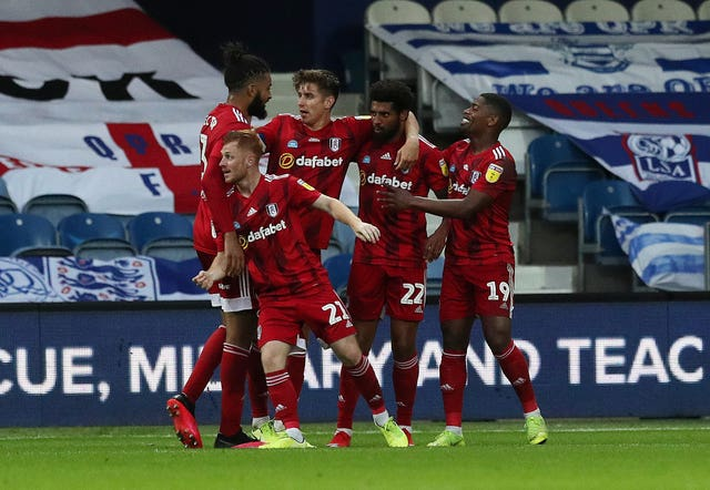 Cyrus Christie (second right) scored Fulham's winner at QPR (Jonathan Brady/PA).