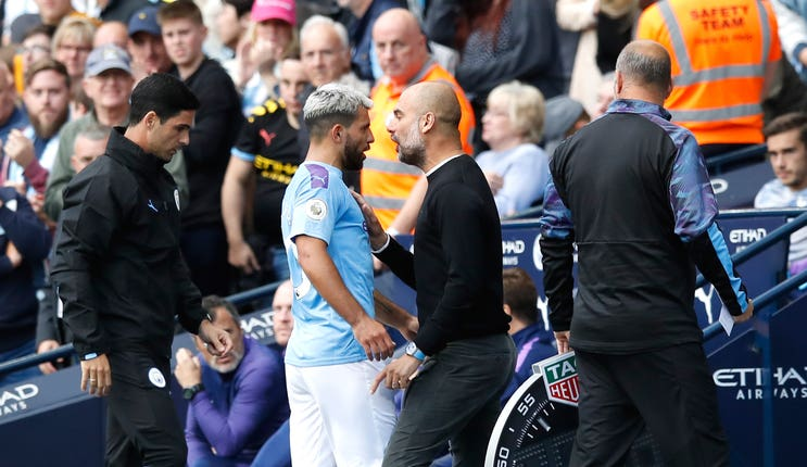 Manchester City manager Pep Guardiola exchanges words with Sergio Aguero
