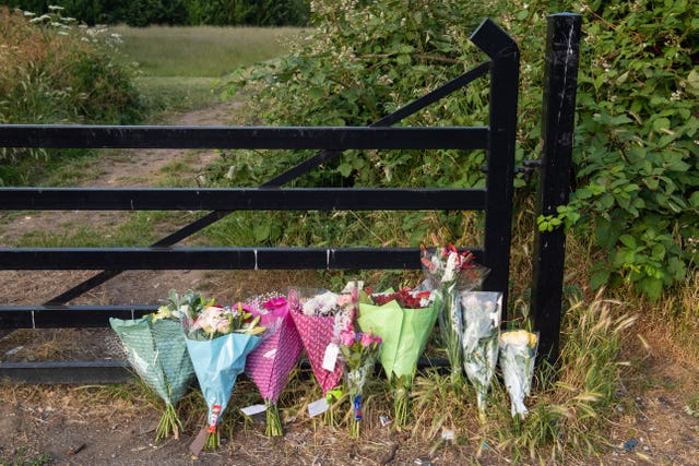 Flowers at an entrance to Fryent Country Park following the murder