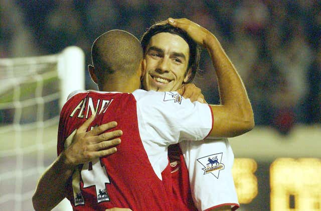 Thierry Henry, left, and Robert Pires embrace after Henry scored against Leeds