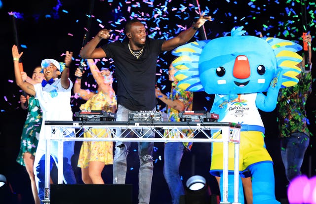 Usain Bolt and Commonwealth Games mascot Borobi the blue koala on stage (Martin Rickett/PA)