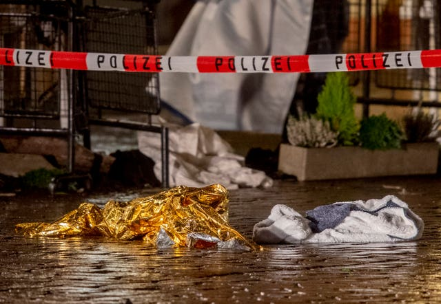 Evidence at the scene (Michael Probst/AP)