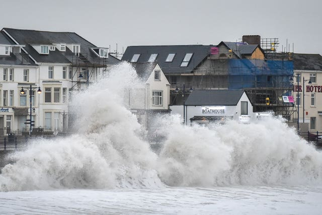 Huge waves hit the sea wall in Porthcawl, Wales, amid hazardous conditions (Ben Birchall/PA)