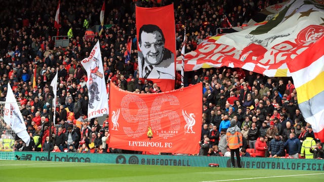 Fans commemorate the 30th anniversary of the Hillsborough disaster before a Premier League match at Anfield, Liverpoo