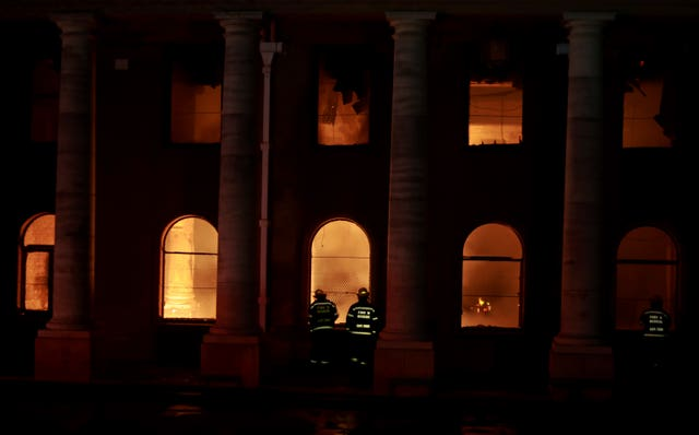 Firefighters douse the destroyed Jagger Library at the University of Cape Town, South Africa