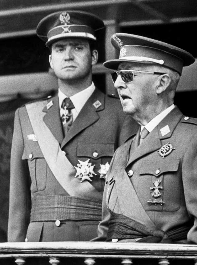Then dictator General Franco of Spain with the then prince Juan Carlos de Bourbon, at a military parade in Madrid (Archive/PA)
