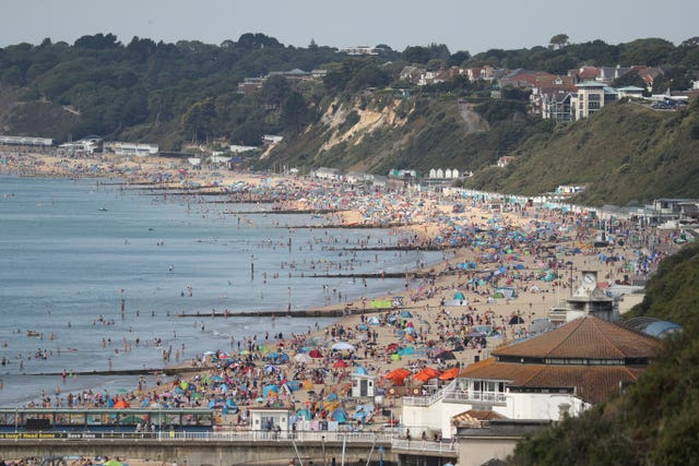 People enjoy the hot weather on Bournemouth beach in Dorset