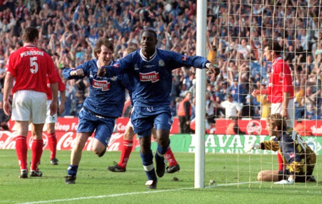 Emile Heskey has revealed he was chased down the street by a Leicester fan before he made his debut