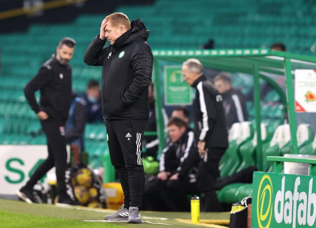 Under-fire Celtic boss Neil Lennon puts his hand to his head during the Scottish League Cup loss to Ross County