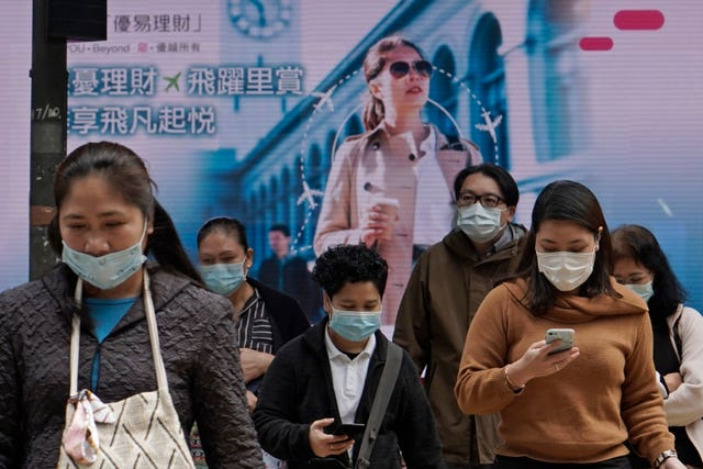 People wearing protective face masks in the business district of Hong Kong