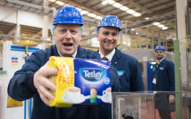 Prime Minister Boris Johnson on the production line during a visit to the Tetley Tea factory in Stockton