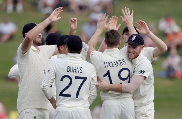 England players congratulate Chris Woakes