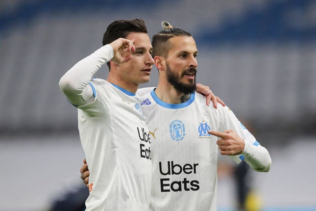 Dario Benedetto (left) celebrates his goal for Marseille