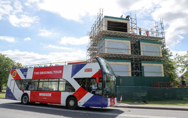 A tour bus making it's way past broadcast studios which are being erected on the Long Walk in Windsor (PA)