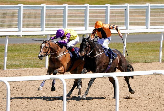 Zodiakos (orange) and jockey James Sullivan en route to a memorable victory in Newcastle.