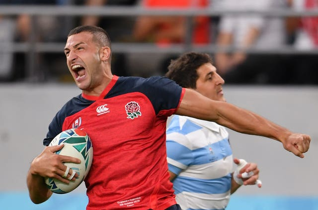Jonny May scores the opening try in the crucial Pool C match against Argentina