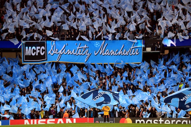 Manchester City supporters create a sea of blue before kick-off at the Etihad
