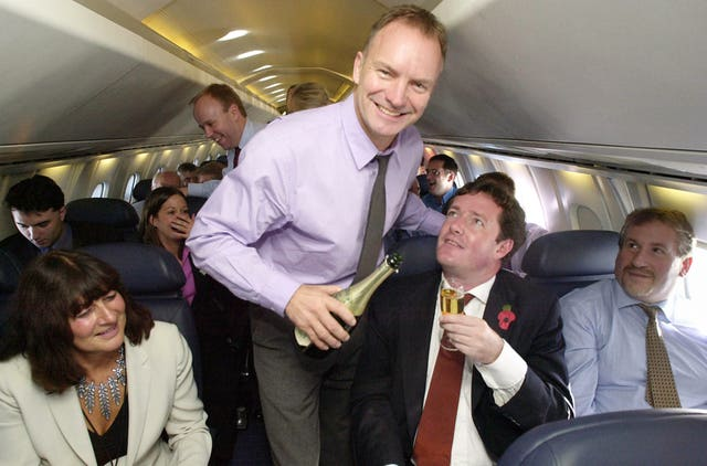 Rock star Sting serves champagne to journalist Piers Morgan on a British Airways Concorde flight (Stefan Rousseau/PA)