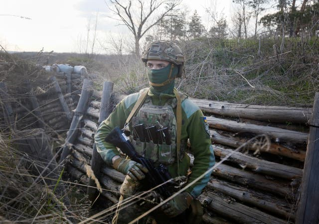 A Ukrainian soldier is seen on the line of separation from pro-Russian rebels near Luhansk, Ukraine