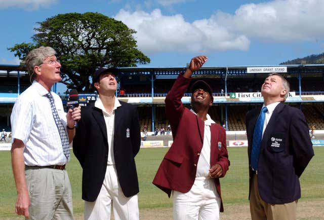 Willis, now a Sky presenter and pundit, watches with England captain Michael Vaughan as West Indies captain Brian Lara tosses a coin in 2004