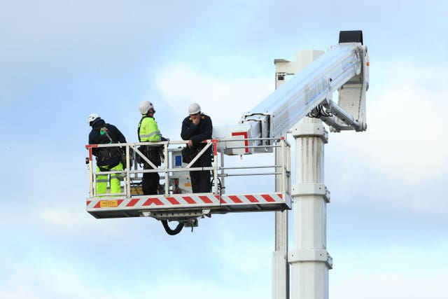A cherry picker was used in the recovery operation (Danny Lawson/PA)