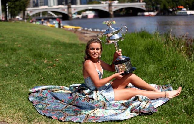 Sofia Kenin parades her Australian Open triumph after she beat Garbine Muguruza at Melbourne Park