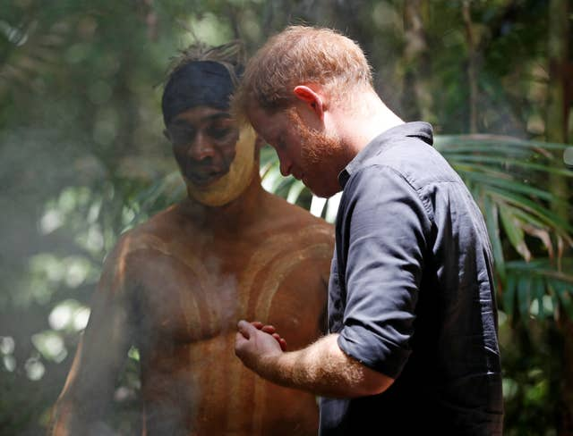 The Duke of Sussex takes part in a smoking ceremony with a member of the Butchulla (Phil Noble/PA)
