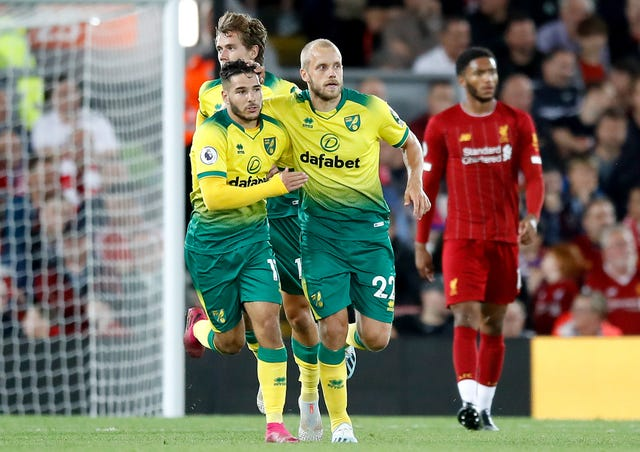 Teemu Pukki, right, celebrates his goal at Anfield