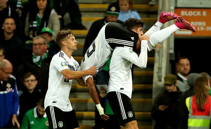 Serge Gnabry, upside down, is picked up in celebration after scoring Germany's second