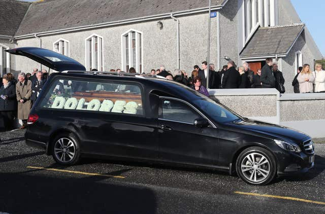 The hearse outside the church following the funeral service( Niall Carson/PA)