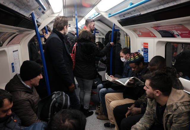 A packed carriage full of passengers travelling on the Victoria line of the London Underground