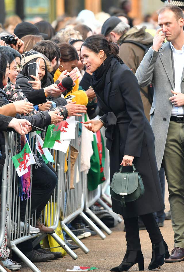 Meghan Markle meets the crowds during a visit to Cardiff Castle (Ben Birchall/PA)