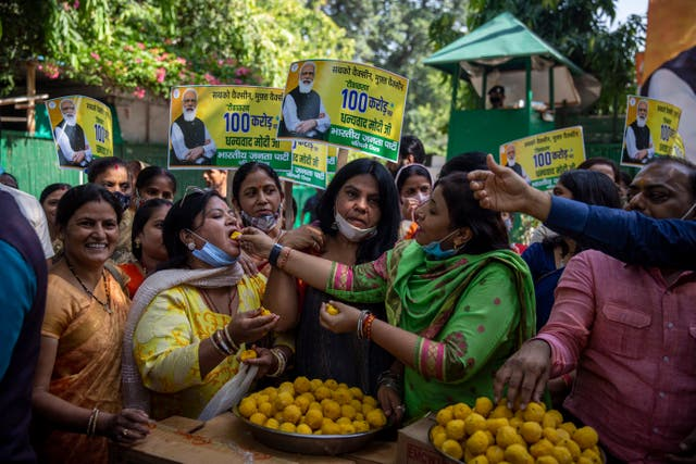 Members of India's ruling party hand out sweets