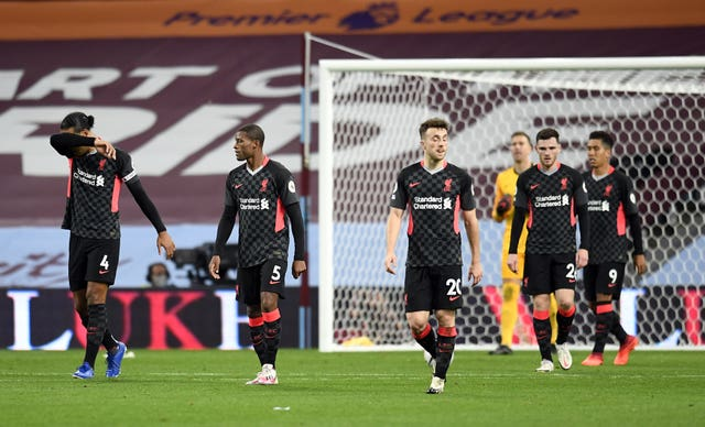 Liverpool's players appear dejected after Aston Villa score their fourth goal on Sunday