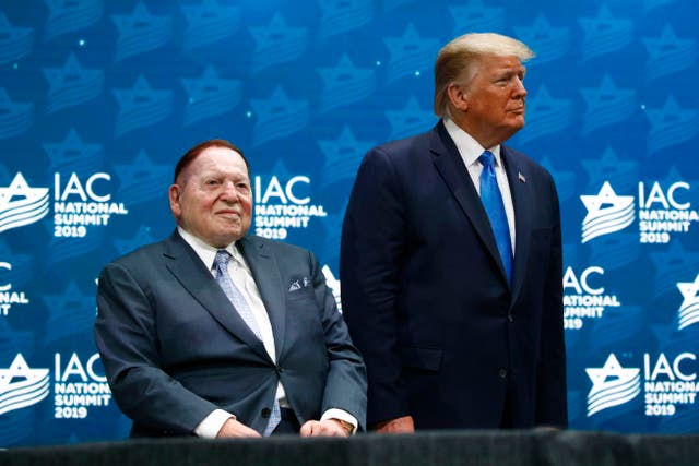 President Donald Trump stands alongside Las Vegas Sands Corporation chief executive and Republican mega donor Sheldon Adelson (Patrick Semansky/AP)