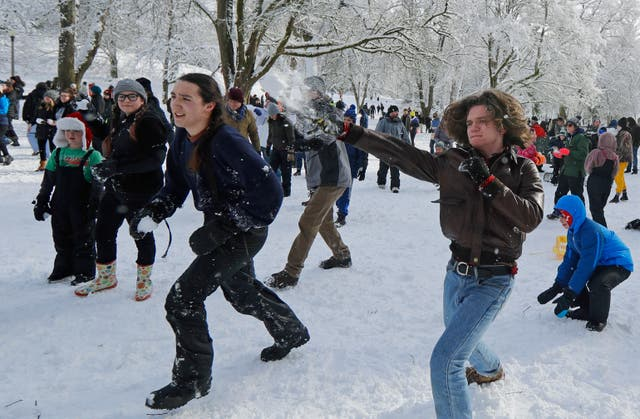 People taking part in the snowball fight