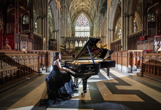 Ke Ma rehearses at York Minster ahead of a performance to highlight the plight of musicians and the arts